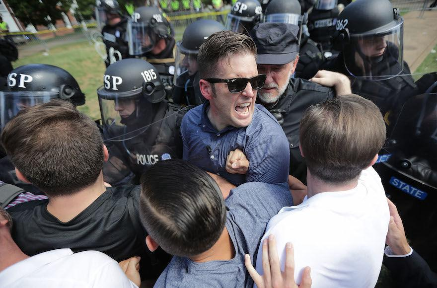 Richard+Spencer%2C+center%2C+and+supporters+clash+with+police+after+the+%22Unite+the+Right%22+rally+in+Charlottesville%2C+Va.%2C+was+declared+unlawful%2C+Aug.+12%2C+2017.+%28Chip+Somodevilla%2FGetty+Images%29