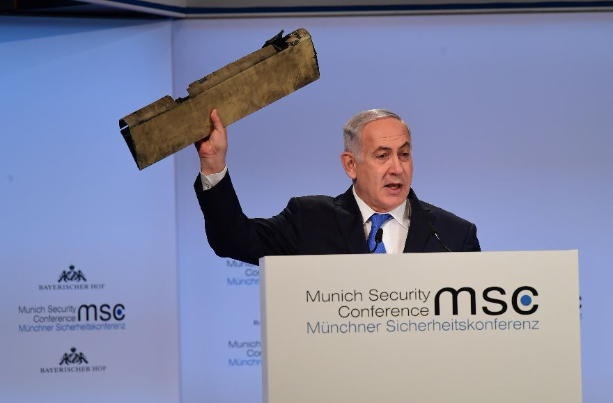 Israeli+Prime+Minister+Netanyahu+waves+a+piece+of+an+Iranian+drone+shot+down+over+northern+Israel+during+an+address+to+the+Munich+Security+Conference%2C+Feb.+18%2C+2018.+%28Amos+Ben-Gershom%2FGPO%29