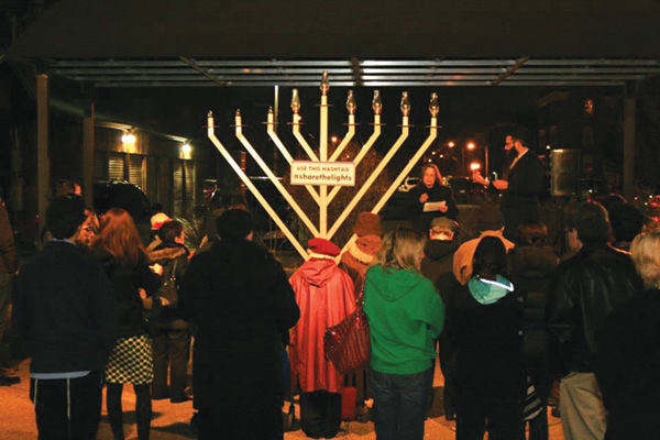 Rabbi Novack of Chabad is joined by University City Council member Paulette Carr at the public Menorah lighting on the Delmar Loop in a previous year.