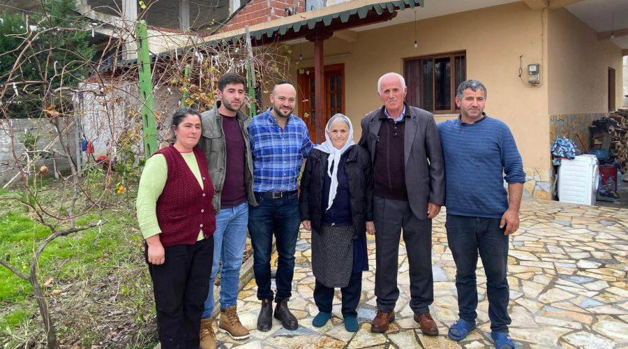 Jonny+Daniels%2C+third+from+left%2C+with+the+Bicaku+family+in+their+home+in+Durres%2C+Albania%2C+Dec.+11%2C+2019.+%28Courtesy+of+From+the+Depths%29