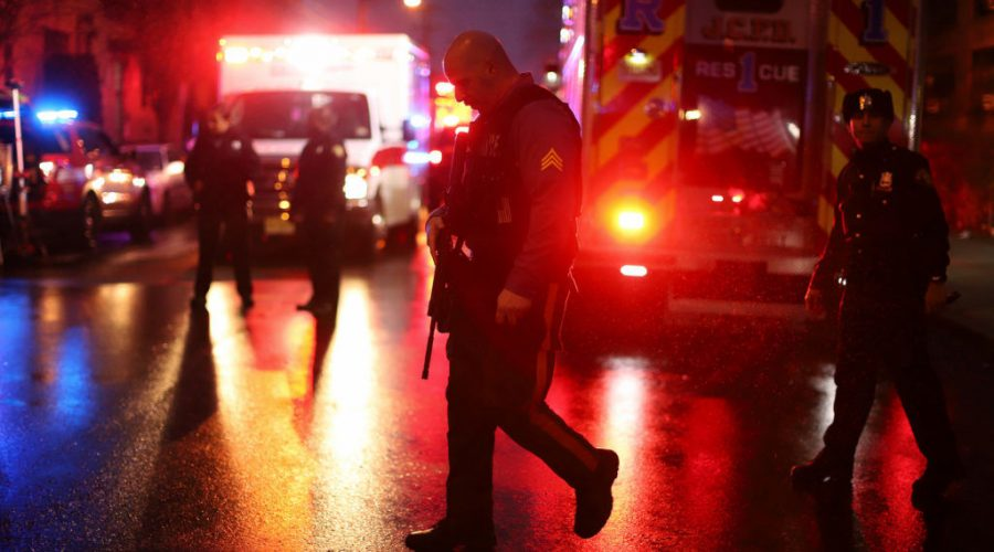 Police+officers+on+the+scene+of+the+shooting+in+Jersey+City%2C+N.J.%2C+that+left+six+dead%2C+Dec.+10%2C+2019.+%28Rick+Loomis%2FGetty+Images%29