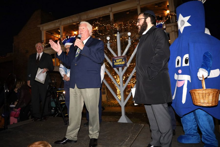 St.+Charles+Mayor+Dan+Borgmeyer+speaks+at+a%C2%A0menorah+lighting%C2%A0ceremony+on+Sunday+night+in+St.+Charles.+At+right%2C+Rabbi+Chaim+Landa+looks+on.+At+the+event%2C+Chabad+announced+plans+to+start+a+new+chapter+serving+Jews+in+St.+Charles%2C+led+by+Landa+and+his+wife%2C+Bassy.
