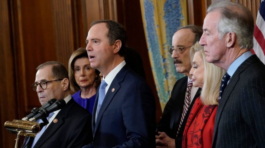 Rep.+Adam+Schiff%2C+at+the+microphone%2C+joins+with+other+House+committee+chairs+and+Speaker+Nancy+Pelosi%2C+second+from+left%2C+to+announce+the+next+steps+in+the+House+impeachment+inquiry%2C+at+the+U.S.+Capitol%2C+Dec.+10%2C+2019.+%28Win+McNamee%2FGetty+Images%29