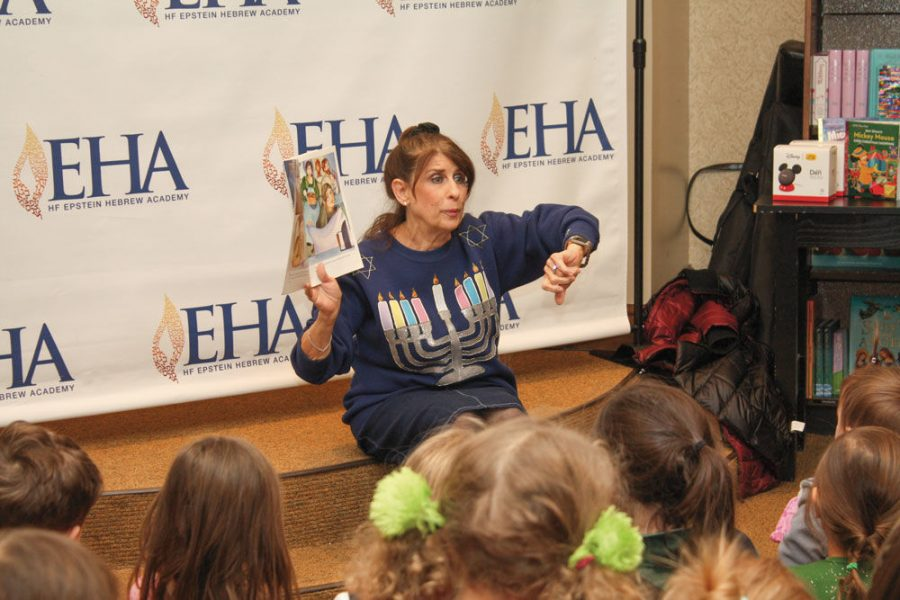 Jackie Oppenheimer leads a storytelling session at a previous Hanukkah celebration at the Schnucks Ladue Crossing shopping center.This year's event takes place Dec. 18.