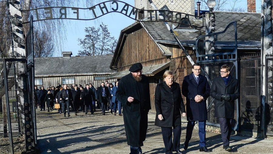 German+Chancellor+Angela+Merkel+and+Poland%27s+Prime+Minister%2C+Mateusz+Morawiecki%2C+second+from+left%2C+receiving+a+tour+by+employees+of+the+former+Auschwitz+Nazi+concentration+camp+near+Krakow%2C+Poland+on+Dec.+6%2C+2019.+%28Omar+Marques%2FGetty+Images%29