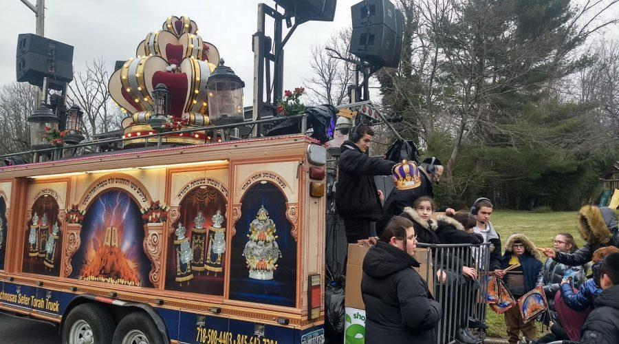 Jewish+children+gathered+near+a+parade+float+to+celebrate+the+dedication+of+a+new+Torah+scroll%2C+blocks+away+from+where+the+stabbing+had+occurred+the+night+before.+%28Ben+Sales%29
