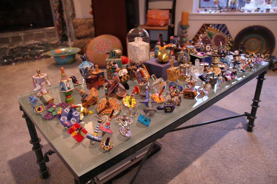 Dreidels+in+a+variety+of+designs%2C+sizes%2C+materials+and+shapes+are+part+of+Leslie+Raynsford%E2%80%99s+collection.+Photo%3A+Eric+Berger