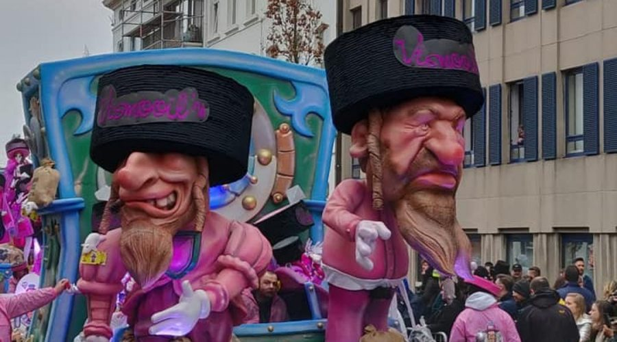 A+parade+float+at+the+Aalst+Carnaval+in+Belgium+features+caricatures+of+Orthodox+Jews+atop+money+bags%2C+March+3%2C+2019.+%28Courtesy+of+FJO%29