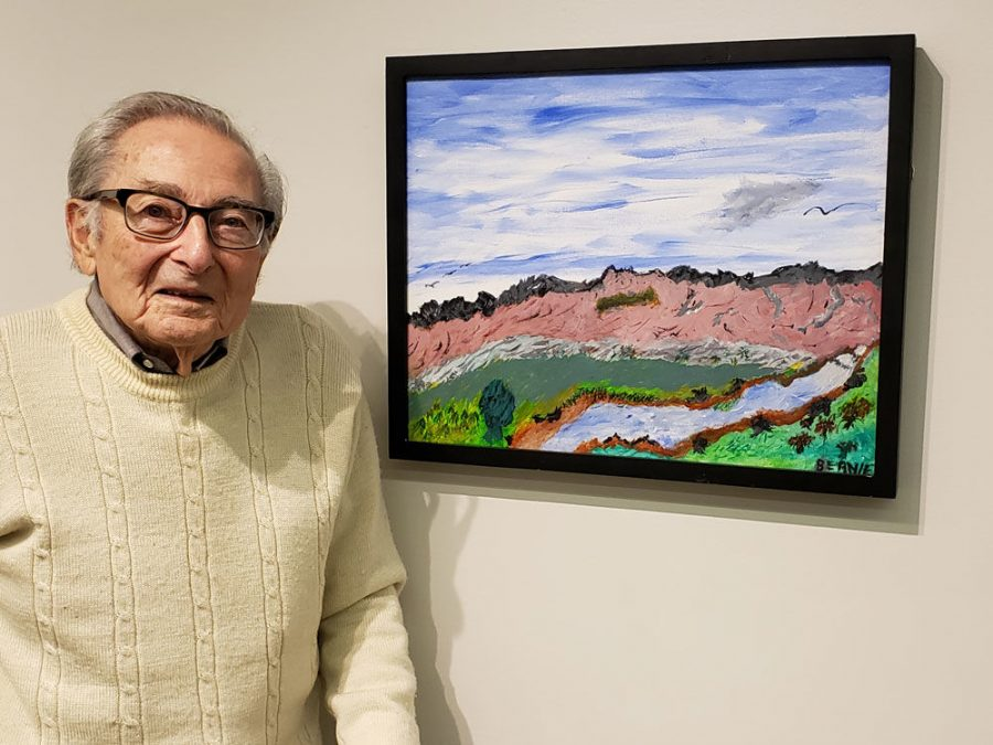 """Covenant Place resident Bernie Rosenberg said he """"traveled through his imagination"""" while painting to a place he had visited when he was younger."""