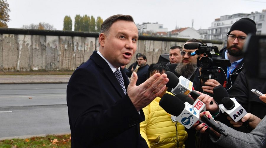 Polish+President+Andrzej+Duda+speaks+to+the+press+in+front+of+remains+of+the+Berlin+Wall%2C+Nov.+9%2C+2019.+%28John+Macdougall%2FAFP+via+Getty+Images%29