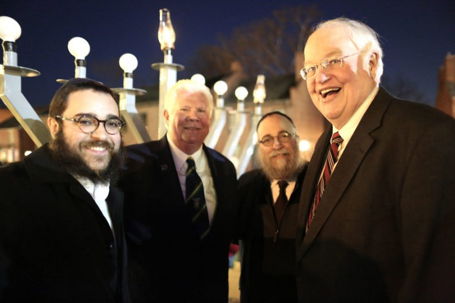 From left to right, Rabbi Chaim Landa, St. Charles Mayor Dan Borgmeyer, Rabbi Yosef Landa and St. Charles County Executive Steve Ehlmann take part in a menorah lighting ceremony in St. Charles on the first night of Hanukkah. At the event, Chabad announced it will start a new branch to serve Jews in St. Charles. Photo: Bill Motchan