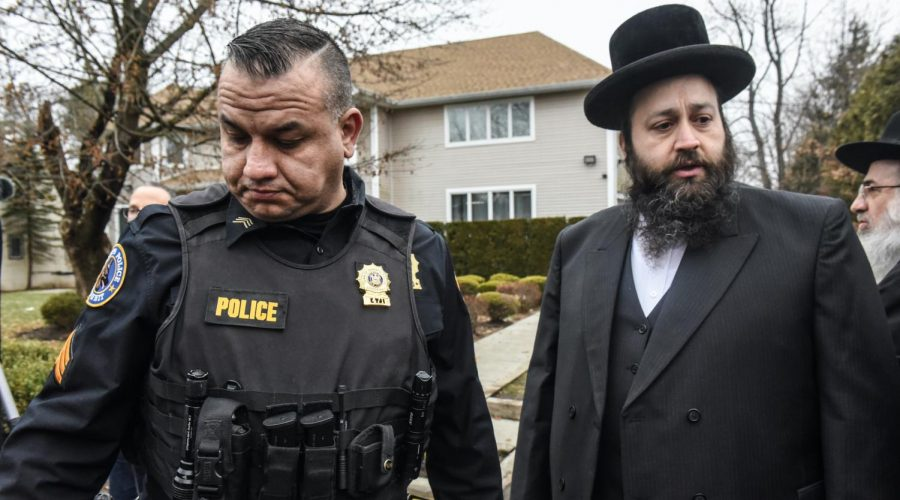 A member of the Ramapo police stands guard in front of the house of Rabbi Chaim Rottenberg in Monsey, N.Y., Dec. 29, 2019. (Stephanie Keith/Getty Images)