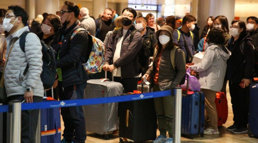 South+Korean+tourists+wear+masks+as+they+wait+for+the+departure+of+their+flight+at+Ben+Gurion+International+Airport+near+Tel+Aviv%2C+Feb.+24%2C+2020.+%28Flash90%29