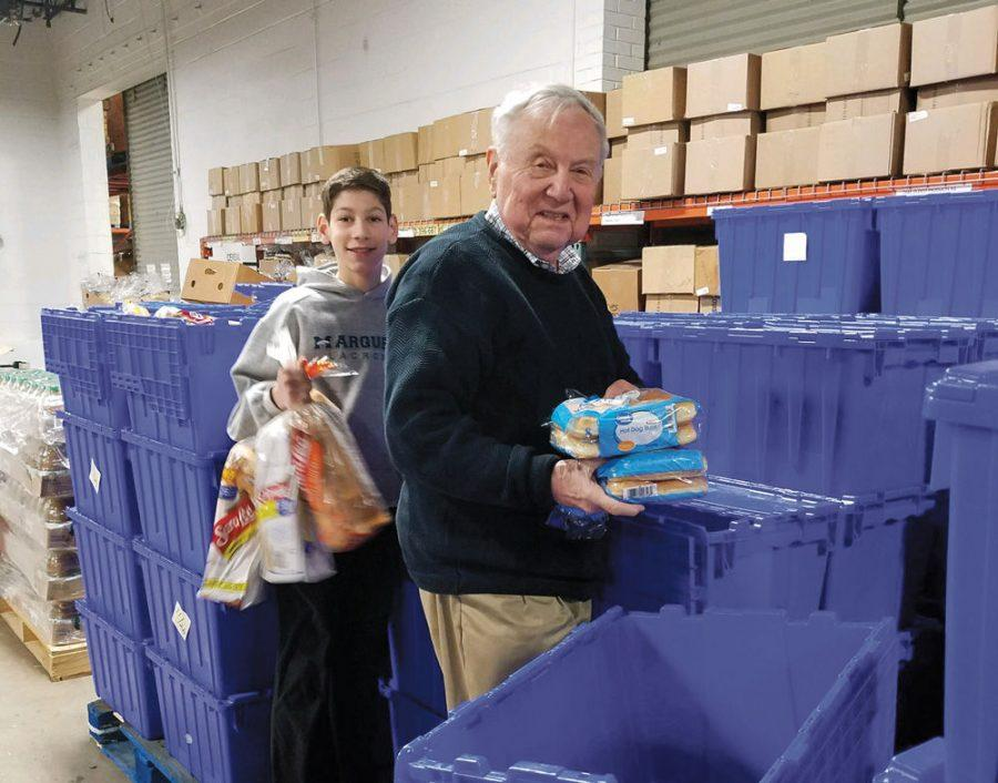 Jason+Morse+and+his+grandfather%2C+Phillip+Recoon%2C+volunteer+at+the+Harvey+Kornblum+Jewish+Food+Pantry.