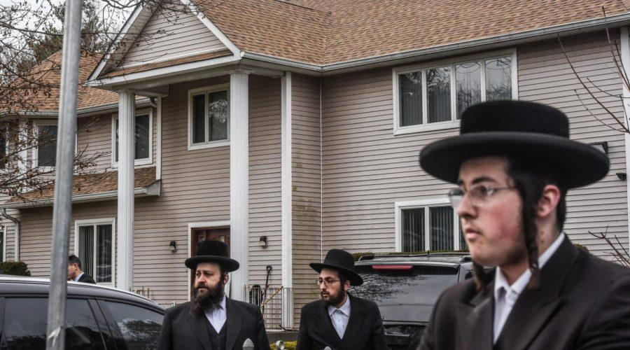 People+gather+in+front+of+the+Monsey+house+of+Rabbi+Chaim+Rottenberg%2C+the+site+of+an+attack+at+a+Hanukkah+party+by+a+machete-wielding+man%2C+Dec.+29%2C+2019.+%28Stephanie+Keith%2FGetty+Images%29