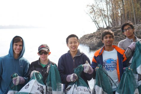 Pictured from left, Evan Schreiner, Harry Shipley, Chris Chen, Rohan Tatikonda, and Avinash Kamath pose for a picture after a hard day of stream cleaning.