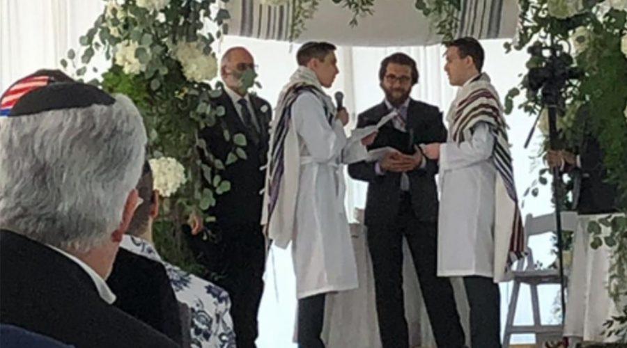 Rabbi+Avram+Mlotek%2C+center%2C+performs+his+first+same-sex+wedding%2C+February+2020.+%28Courtesy+of+Mlotek%29%C2%A0