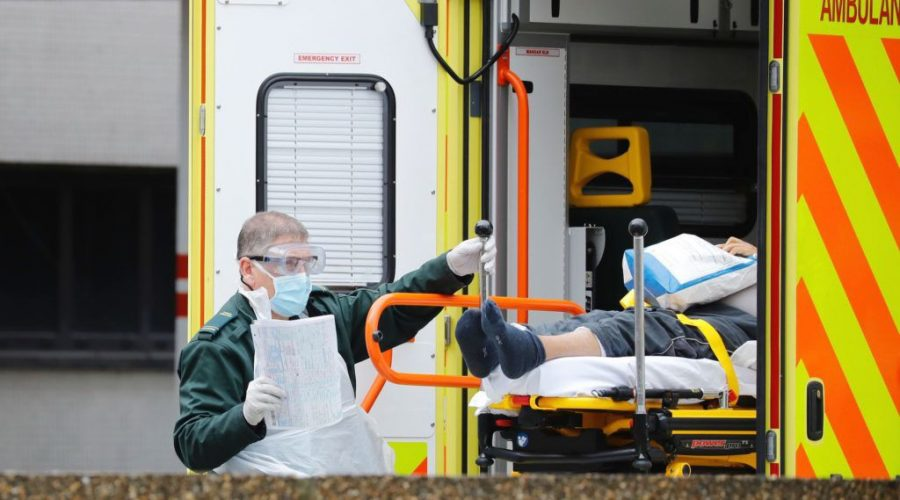 An+ambulance+worker+moves+a+patient+from+an+ambulance+to+St.+Thomas%27+Hospital+in+London%2C+March+31%2C+2020.+%28Tolga+Akmen%2FAFP+via+Getty+Images%29