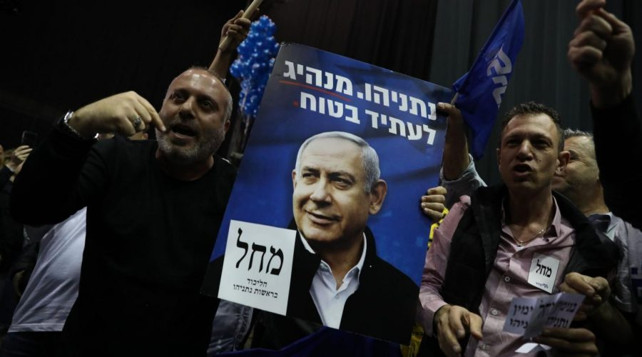 Likud+supporters+displaying+a+poster+of+Prime+Minister+Benjamin+Netanyahu+celebrate+at+party+headquarters+in+Tel+Aviv+following+the+release+of+the+first+exit+polls+showing+their+party+on+top%2C+March+2%2C+2020.+Photo%3A+Olivier+Fitoussi%2FFlash90