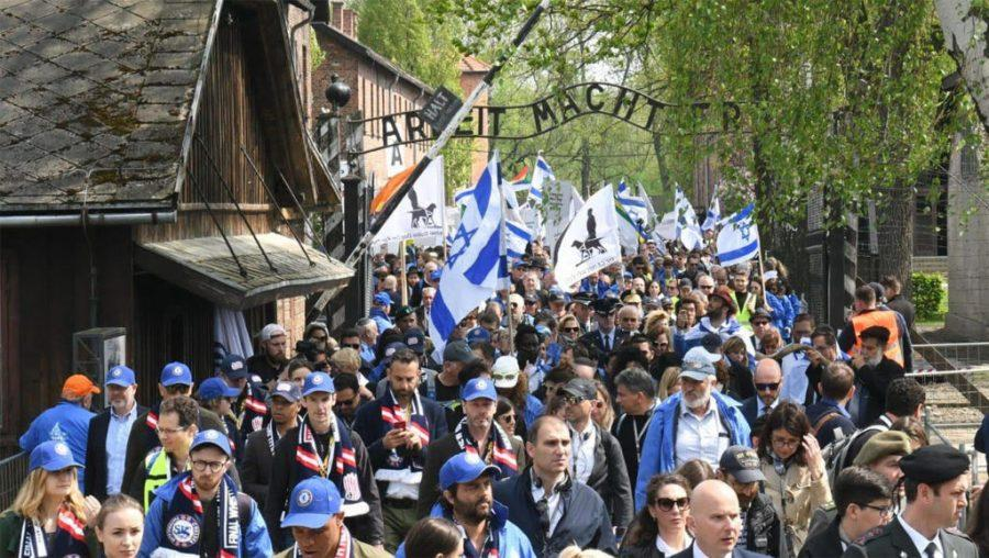Participants+of+the+March+of+the+Living+exit+a+gate+in+the+former+Nazi+camp+Auschwitz+in+Poland%2C+May+2%2C+2019.+%28Courtesy+of+the+International+March+of+the+Living%29
