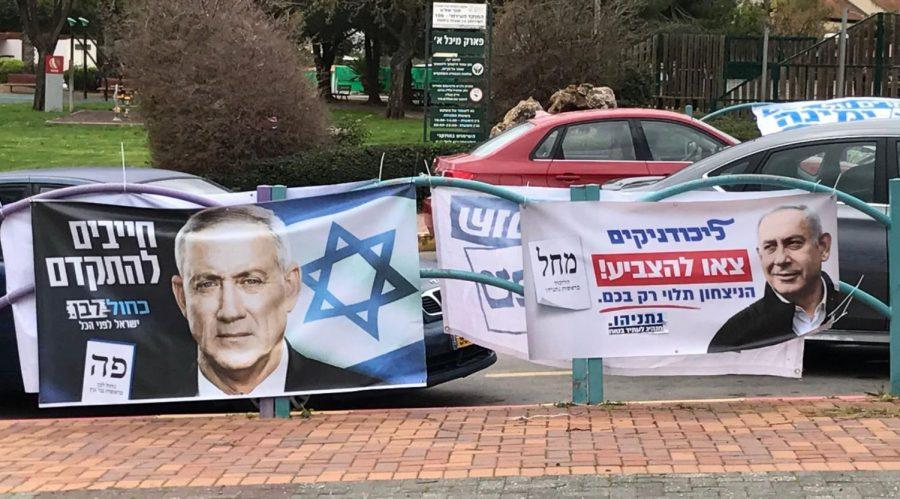 Campaign+signs+for+Blue+and+White+and+the+Likud+Party+jockey+for+attention+outside+of+a+polling+station+in+Karnei+Shomron+on+March+2%2C+2020.+%28Marcy+Oster%29