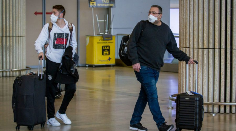 People+wearing+face+masks+for+fear+of+the+coronavirus+at+the+Ben+Gurion+International+Airport+on+February+27%2C+2020.+Photo+by+Flash90
