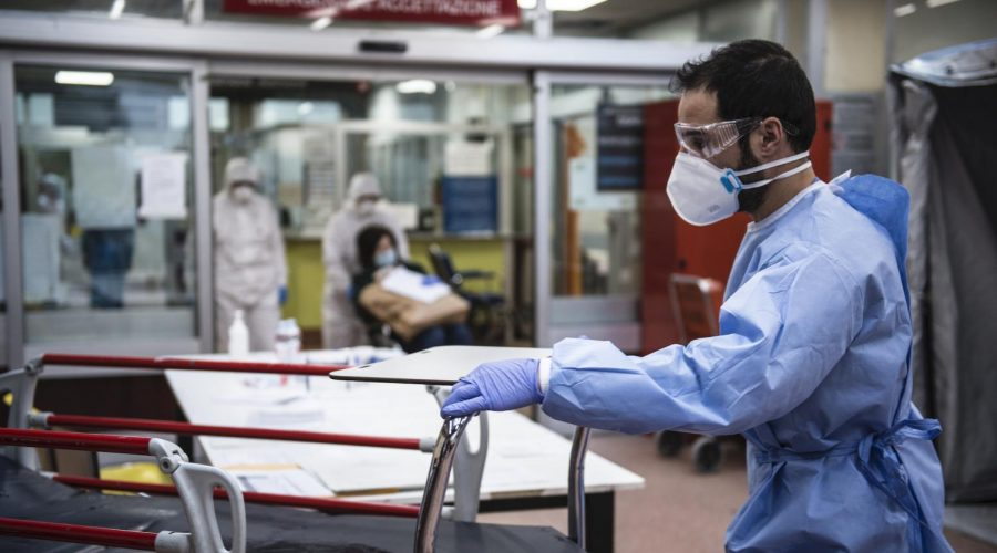 Medical+personnel+in+protective+suits+await+the+arrival+of+possible+COVID-19+infections+in+the+Molinette+Hospital+lobby+in+Turin%2C+Italy%2C+March+26%2C+2020.+%28Stefano+Guidi%2FGetty+Images%29