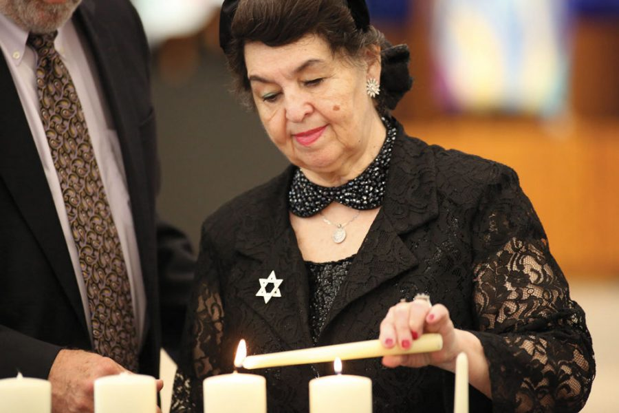 Holocaust+survivor+Larisa+Graypel+lights+a+candle+of+remembrance+at+the+2019+Yom+HaShoah+Community+Commemoration+organized+by+the+Holocaust+Museum+and+Learning+Center+of+St.+Louis+and+held+at+Congregation+Shaare+Emeth.%C2%A0%C2%A0