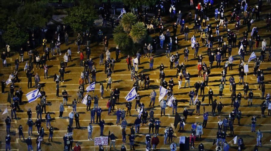 Israelis+wearing+protective+masks+and+dressed+mainly+in+black+take+part+in+a+demonstration+on+April+25%2C+2020%2C+in+Tel+Avivs+Rabin+Square+to+protest+what+they+consider+threats+to+Israeli+democracy.+They+stood+2+meters+apart+because+of+the+coronavirus+pandemic.+%28Photo+by+JACK+GUEZ%2FAFP+via+Getty+Images%29%C2%A0