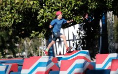 """Caption: Jeff Baumgarten, 11, runs across an obstacle that requires running across a series of spinning blocks.Jeff competes in an episode of """"American Ninja Warrior Junior"""" premiering May 15.Photo by: Eddy Chen/Universal Kids"""