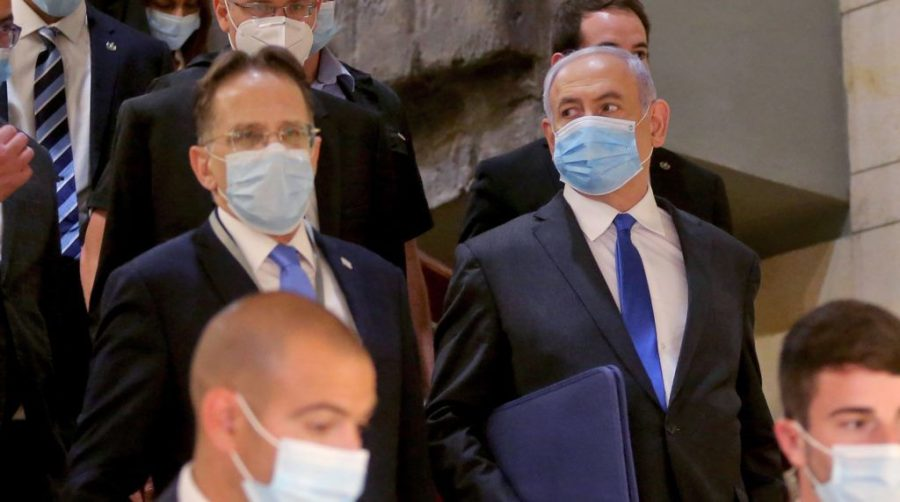 Israeli+Prime+Minister+Benjamin+Netanyahu+%2C+right%2C+wearing+a+protective+face+mask%2C+arrives+for+the+swearing-in+ceremony+at+Israel%27s+parliament%2C+the+Knesset%2C+in+Jerusalem%2C+May+17%2C+2020.+%28Alex+Kolomiensky%2FPool%2FAFP+via+Getty+Images%29