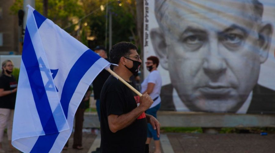 People+gather+to+stage+a+demonstration+to+protest+against+the+annexation+plan+of+the+Jordan+Valley%2C+located+in+the+occupied+West+Bank+and+illegal+Jewish+settlements+in+West+Bank%2C+Tel+Aviv%2C+Israel+on+June+6%2C+2020.+%28Nir+Keidar%2FAnadolu+Agency+via+Getty+Images%29