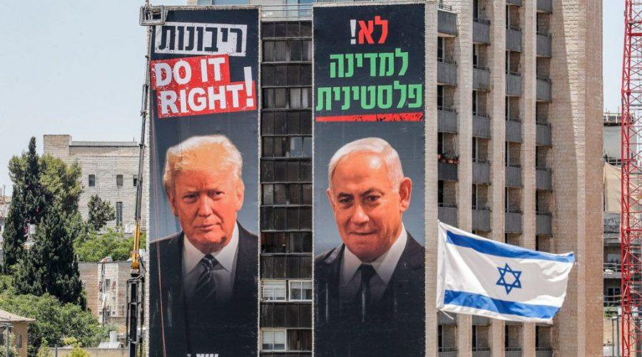 Giant+posters+on+buildings+in+Jerusalem+feature+photos+of+Israeli+Prime+Minister+Benjamin+Netanyahu+%28right%29+and+President+Donald+Trump%2C+beneath+slogans+supporting+West+Bank+annexation+and+opposing+a+Palestinian+state.+They+were+hung+by+the+Yesha+Council%2C+an+umbrella+organization+of+Israeli+settlements+in+the+West+Bank%2C+which+is+split+on+Netanyahu%27s+annexation+plan.+%28Ahmad+Gharbali%2FAFP+via+Getty+Images%29