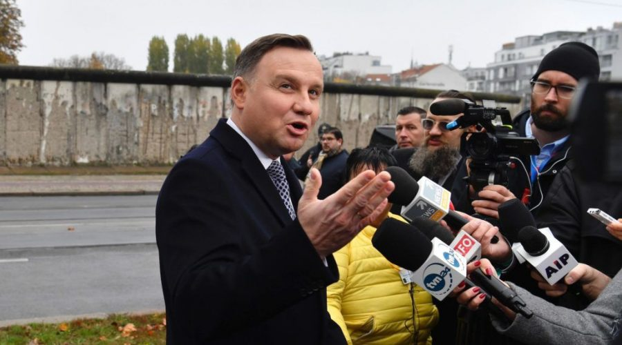 President+Andrzej+Duda+of+Poland+speaks+to+the+media+in+front+of+remains+of+the+Berlin+Wall%2C+Nov.+9%2C+2019.+%28John+Macdougall%2FAFP+via+Getty+Images%29