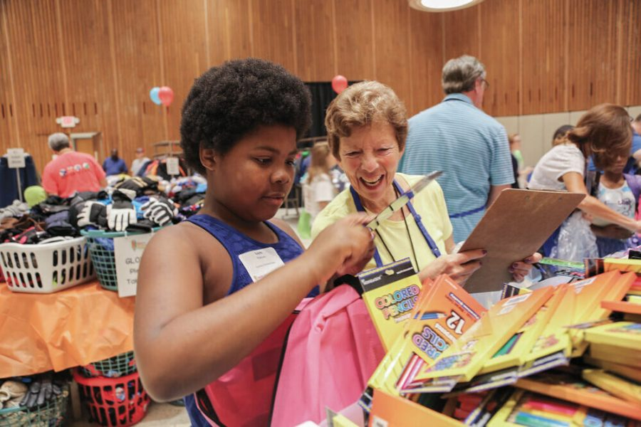 In+this+2018+file+photo%2C+Joy+Sterneck+volunteers+at+the+Jewish+Women%E2%80%99s+Back+to+School%21+Store.The+annual+event+helps+provide+back+to+school+essentials+for+children+in+need.