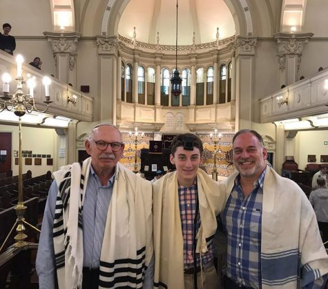 Henry Rosenblum is flanked by his grandfather, Doron Berger (left), and his father, Steven Rosenblum at the Garden Shul Synagogue in Cape Town, South Africa.