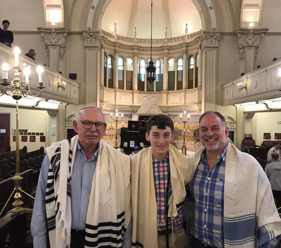 Henry+Rosenblum+is+flanked+by+his+grandfather%2C+Doron+Berger+%28left%29%2C+and+his+father%2C+Steven+Rosenblum+at+the+Garden+Shul+Synagogue+in+Cape+Town%2C+South+Africa.%C2%A0%C2%A0