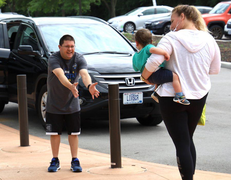Brett Kalmes picks up his son,Elliot,at the end of the day at B'nai Amoona's Linda Rotskoff Early Childhood Center.