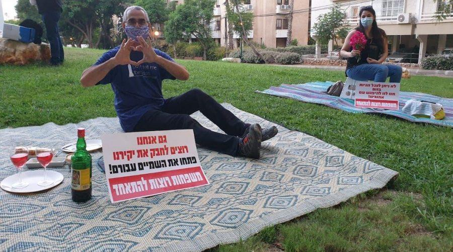 Israelis+protest+being+separated+from+their+significant+others+outside+the+residence+of+the+foreign+minister+by+having+solo+romantic+picnics+on+the+eve+of+Tu+B%27Av%2C+the+Jewish+day+celebrating+love.+The+signs+read%2C+%22We+also+want+to+embrace+our+loved+ones.+Open+the+skies+for+them.+Families+want+to+be+together.%22+%28Courtesy+of+Plia+Kettner%29