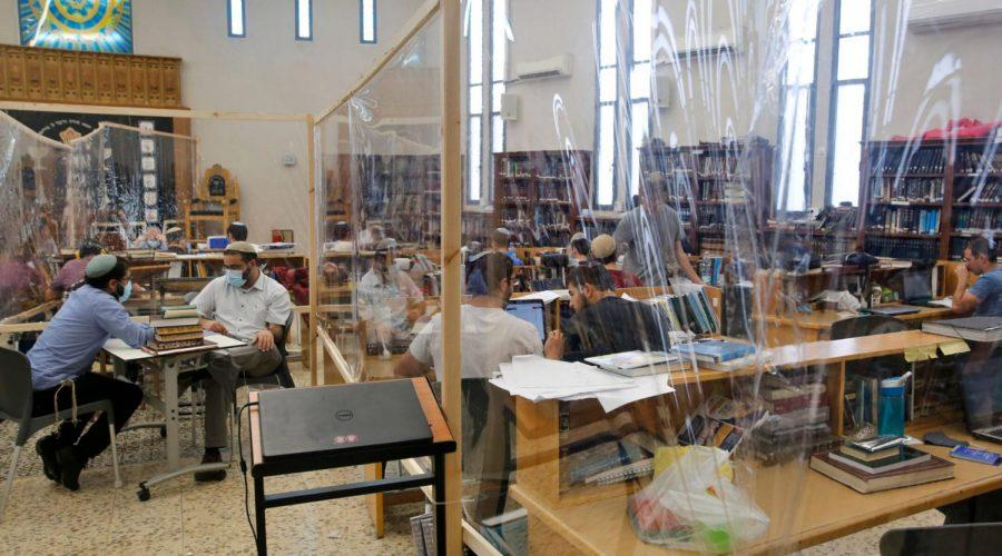 Israeli+yeshiva+students+are+separated+by+plastic+barriers+to+insure+that+social+distancing+measures+imposed+by+Israeli+authorities+are+being+respected%2C+in+Tel+Aviv+on+July+7%2C+2020.%C2%A0