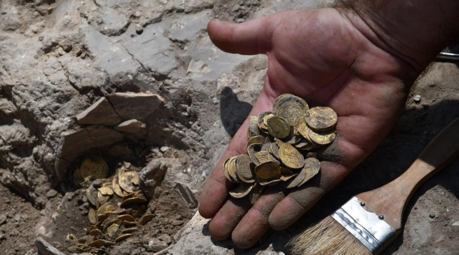 Some of the gold coins discovered in an archaeological excavation during the construction of a neighborhood in the center of Israel. (Yoli Schwartz/Israel Antiquities Authority)
