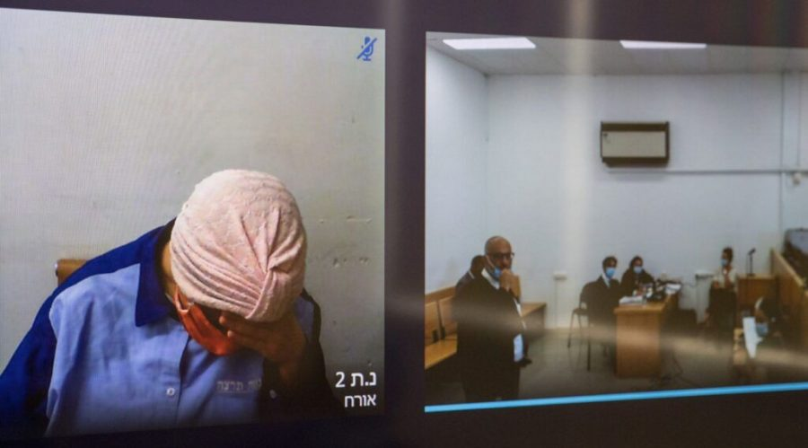 Malka Leifer, a former Australian day school principal accused of dozens of cases of sexual abuse of girls at the school, seen on a screen via a video link during a court hearing at the Jerusalem District Court, July 20, 2020. (Yonatan Sindel/Flash90)