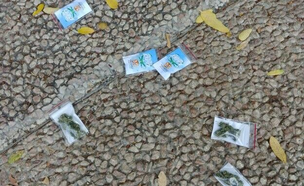 Bags of marijuana litter the street in Tel Aviv. (Israel Police)