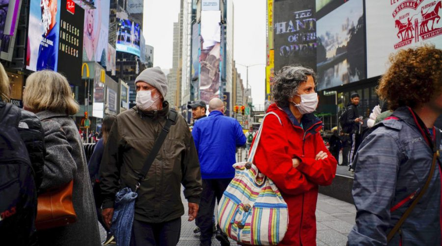 People wear face masks in Times Square in New York City, March 3, 2020, after the city confirmed cases of the rapidly spreading coronavirus. (Photo: Eduardo Munoz/VIEWpress via Getty Images)