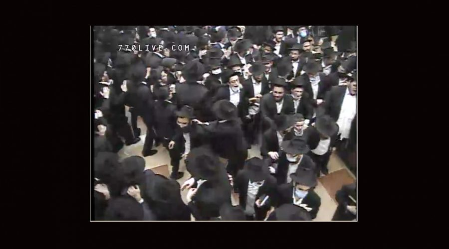 Worshippers danced late into the night at 770 Eastern Parkway in Brooklyn after Selichot services early on Sunday, Sept. 13, 2020. (Screenshot from livestream)