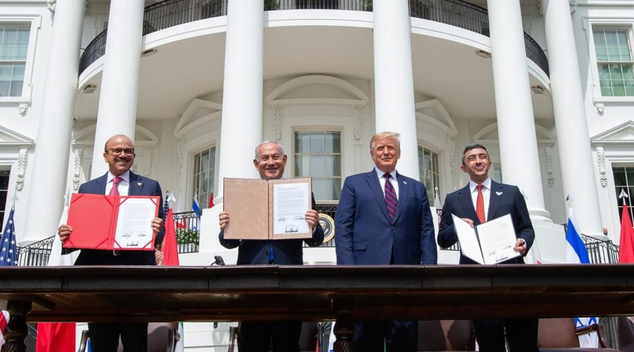 From left, Bahrain Foreign Minister Abdullatif al-Zayani, Israeli Prime Minister Benjamin Netanyahu, President Donald Trump and UAE Foreign Minister Abdullah bin Zayed Al Nahyan at the signing of the Abraham Accords at the White House, Sept. 15, 2020. (Saul Loeb/AFP via Getty Images)