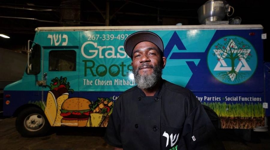 Troy Harris in front of his Grassroots kosher food truck. (Joseph Kaczmarek)