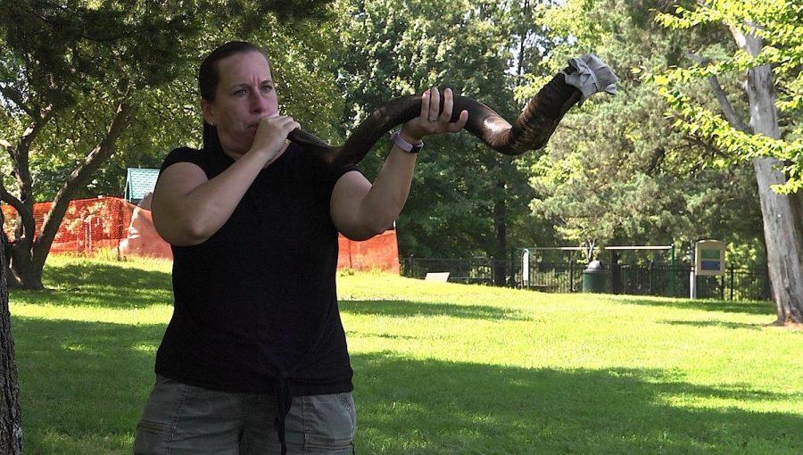 Rabbi Brigitte Rosenberg of United Hebrew Congregation sounds the shofar at Millennium Park in Creve Coeur. Photo: Wyatt Weed