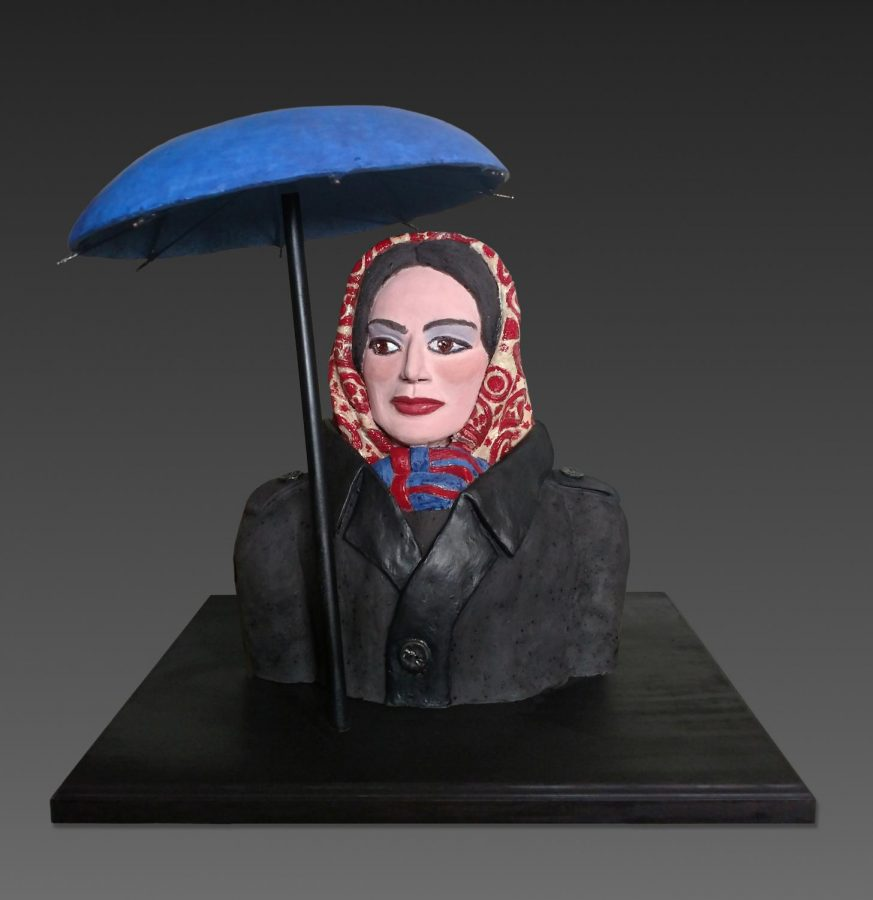 Sandy Kaplans Ada With Blue Umbrella (2020)Kaplan explained: This sculpture is based on a painting by contemporary artist, Alex Katz, whose wife, Ada, was his favorite subject. The bust sits on a separate wooden base that was built specifically for this piece and has a hole to hold the umbrella in place. The umbrella is a separate piece that gets attached to the base.