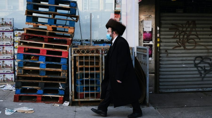 An Orthodox Jewish man walks through the Borough Park neighborhood of Brooklyn, April 8, 2020. (Spencer Platt/Getty Images)